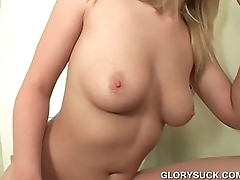 Chesty blonde loves eating cock on gloryhole