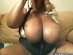 Big tits Stygian BBW deepthroats a dildo and toys her pussy