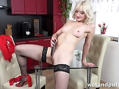 Sexy blonde regarding stockings pleases herself with dildo