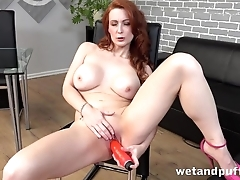Luxurious red-haired MILF stuffs cunny with overheated toy