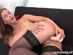 Teen with perky tits tests dildo in the alive room