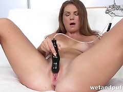 Comely girl tests various sex toys in living room