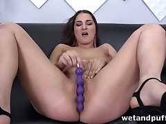 Dazzling MILF sticks sex toys into pussy by means of solo