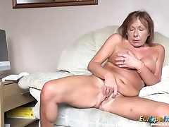 Old bitch undresses and fingers her mature twat