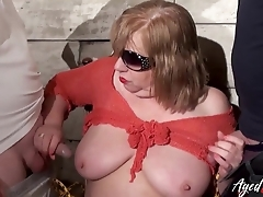 Fat mature floozie enjoys blowing two dominating dicks