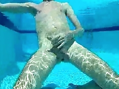 Slim boy play with cock in pool part 2