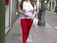 Red cameltoe walking adjacent to the street